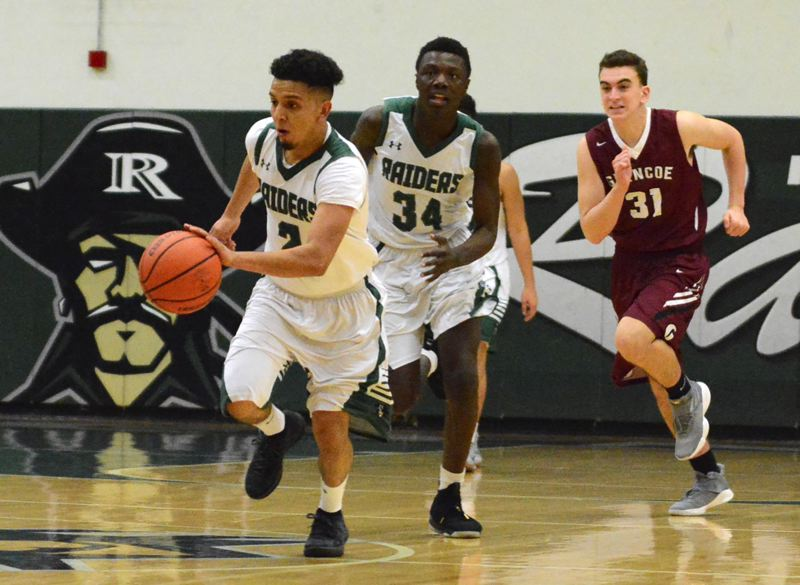 OUTLOOK PHOTO: DAVID BALL - Reynolds point guard Eric Martinez moves down the floor, while temmate Jamarkus Taylor trails on the fastbreak during a win over Glencoe.
