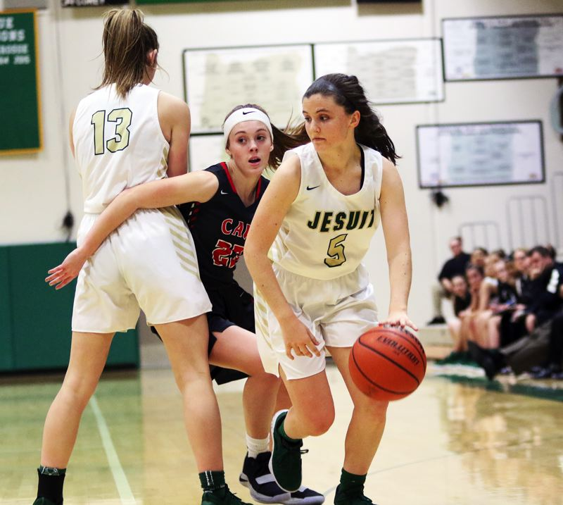TIMES PHOTO: DAN BROOD - Jesuit senior guard Anna Fanelli (right) moves behind a screen set by junior teammate Kailynn Tuck during the Crusaders' 48-31 win over Clackamas.