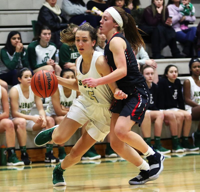 TIMES PHOTO: DAN BROOD - Jesuit senior Rachel Hickey (left) looks to drive the baseline against a Clackamas defender during the Crusaders' win on Wednesday.