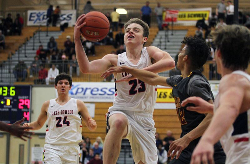 REVIEW FILE PHOTO - Lake Oswego senior guard Josh Angle and the Lakers return to the court when they host North Medford at 7 p.m. tonight.