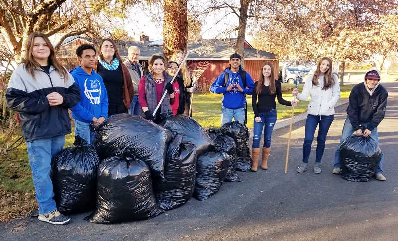 SUBMITTED PHOTO - MHS FFA members who raked up bags of leaves included, from left, Shain Beymer, Derrick Brooks, Halei Manu, how owner Stephen Hillis, Mary Olney, Natalia Oliveras, Noelle Saunders, Matthew Bunt, Jahnessa Gephart, Brooks Ramey and Chris Aylett.