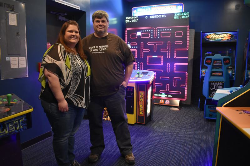 OUTLOOK PHOTO: SHANNON O. WELLS - Troutdale residents Becky and Alan Schmid added a coin-operated video arcade to complement their expanded collection of classic and cutting-edge games and gaming accessories.