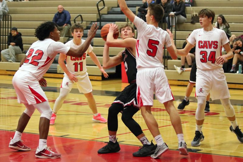 PAMPLIN MEDA: JIM BESEDA - Sandy's Pierce Roeder (with ball) is surrounded by Clackamas defenders Jailen Hammer (22), Artur Gravilovich (11), Daniel Mahler (5), and Ryan Lewis (34) during the second half of Friday's game.
