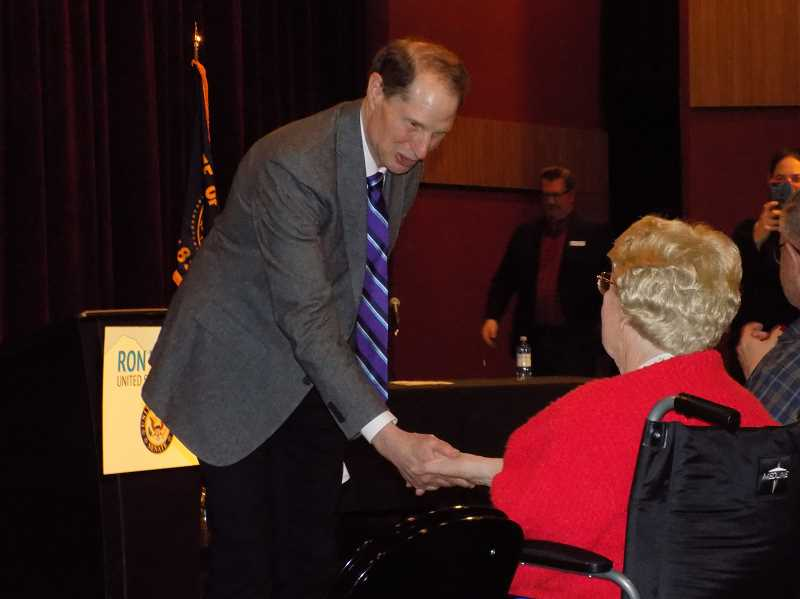 TIMES PHOTO: RAY PITZ - U.S. Sen. Ron Wyden congratulates June Close of Sherwood after presenting her with her first husband's World War II medals during a Town Hall on Friday, Jan. 4. Close was married to Vernon Garner who was killed after the ship he was on was struck by a Japanese torpedo.