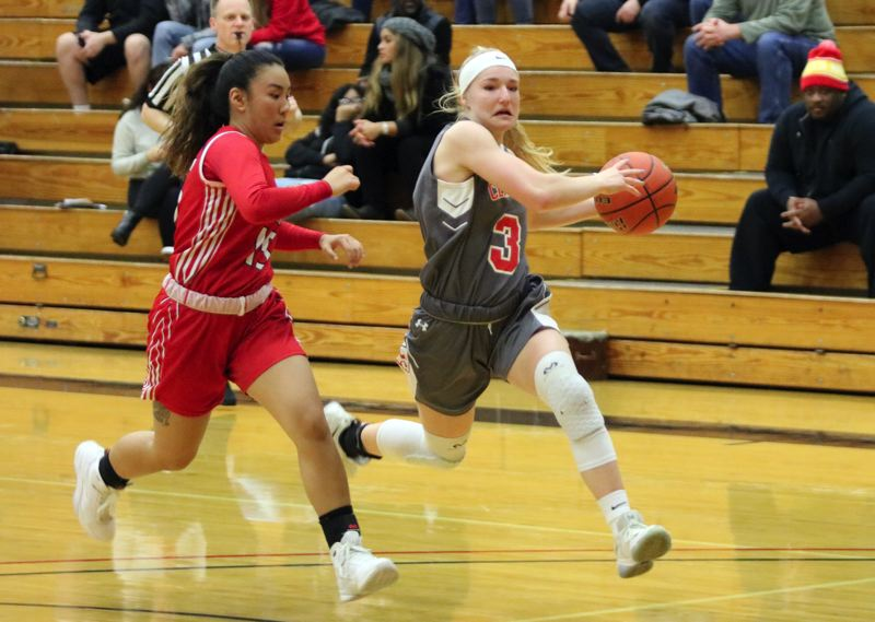 PAMPLIN MEDIA: JIM BESEDA - Clackamas Community College's Paige Downer (3) has a step on Southwestern Oregon's Keiko Aotaki as she drives to the basket during Saturday's NWAC women's basketball game.