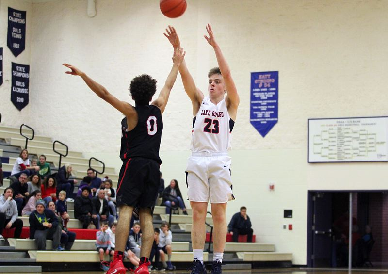 REVIEW PHOTO: MILES VANCE - Lake Oswego senior guard Josh Angle hit a buzzer-beating 3-pointer at the end of the first quarter to fuel his team's 70-41 home win over North Medford on Friday.