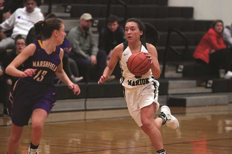PHIL HAWKINS - North Marion sophomore Mya Hammack scored seven of her 13 points in the opening quarter, helping the Huskies rally from an early 9-2 deficit.