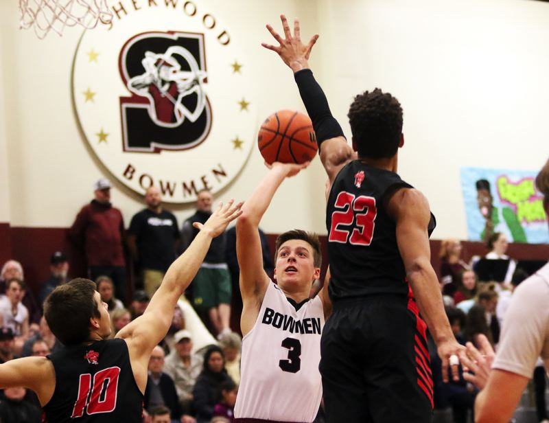 TIMES PHOTO: DAN BROOD - Sherwood senior Tyler Hix (3) looks to take a jump shot during Friday's non-league game against Oregon City.