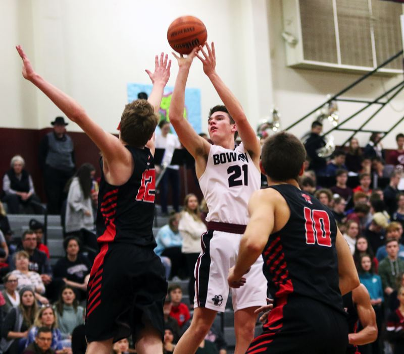 TIMES PHOTO: DAN BROOD - Sherwood High School senior Braden Thorn takes a jump shot during Friday's game against Oregon City.