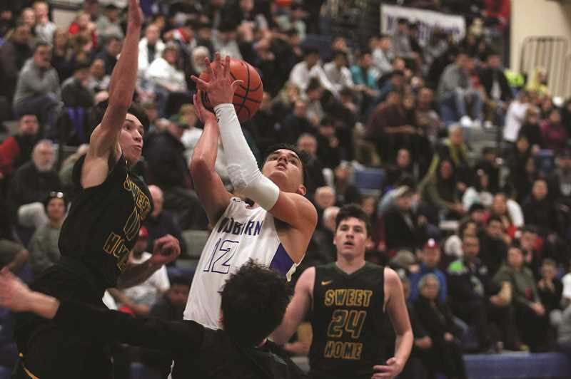 PHIL HAWKINS - Woodburn senior R.J. Veliz scored a game-high 23 points, including 11 in the second quarter when the Bulldogs pulled ahead by double digits over Sweet Home.