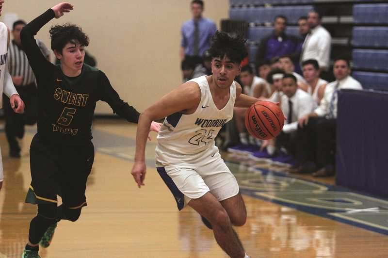 PHIL HAWKINS - Woodburn sophomore Jeovanny Marroquin drives toward the pain in the Bulldogs 61-47 victory over Sweet Home.