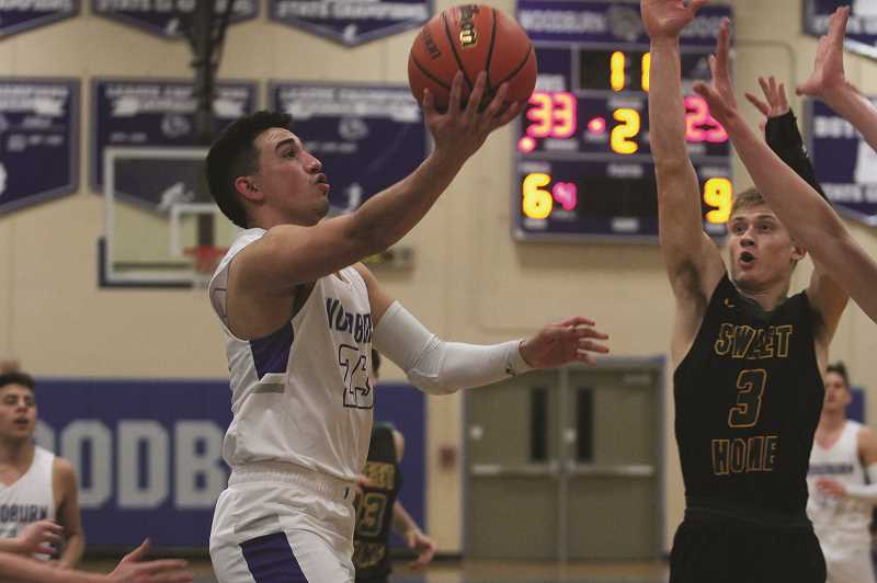 PHIL HAWKINS - Woodburn senior E.J. Barajas scored nine points for the Bulldogs against Sweet Home.