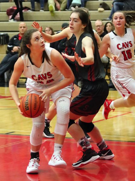 PAMPLIN MEDIA: JIM BESEDA - Sandy's Jackie McCrea (right) puts defensive pressure on Clackamas' Maddie Tacheny during the second half Friday.
