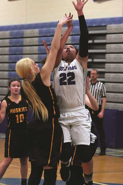 PHIL HAWKINS - Woodburn senior Tatiana Garcia scored nine points, all in the first half, against the Sweet Home Huskies on Friday.