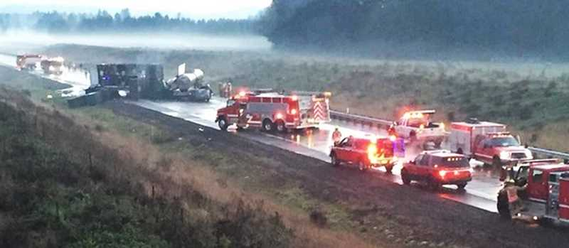 PHOTO COURTESY OF KOIN-TV - The drivers of two tractor-trailer rigs were killed and a third motorist injured during a collission early Monday morning that closed the Newberg-Dundee bypass for hours.