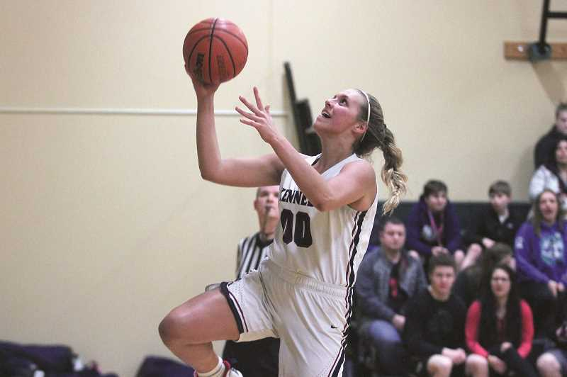 PHIL HAWKINS - Kennedy junior Sophia Carley goes up for a layup in the Trojans 81-28 win over Gold Beach on Thursday.