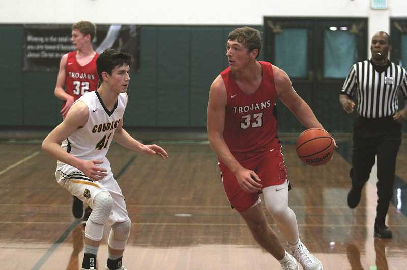 PHIL HAWKINS - Kennedy senior Rocco Carley led the Trojans with 10 points in the teams opening round loss to Portland Adventist on Thursday.