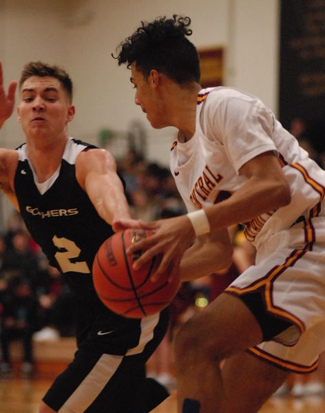 OUTLOOK PHOTO: DAVID BALL - Central Catholic's Kevin James turns back to the basket after collecting a rebound, while Gresham's Connor Henkle looks to knock the ball loose.