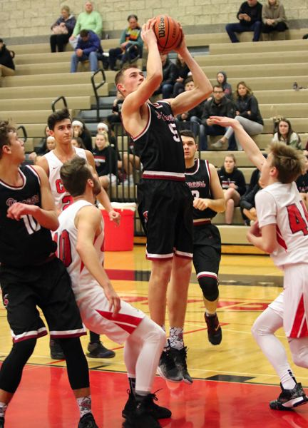 PAMPLIN MEDIA: JIM BESEDA - Sandy's Tanner Brewster gets loose under the basket for two of his 12 points in Friday's 77-63 loss at Clackamas.