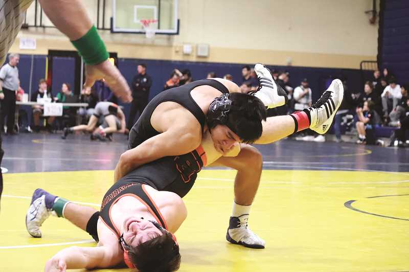 COURTESY WOODBURN WRESTLING - Woodburn junior Hector Paniagua defeated Parker Inman of Beaverton in 1:20 to advance to the semifinals of the 138-pound bracket at Canby on Dec. 22.