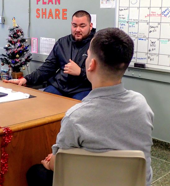 COURTESY PHOTO: OREGON YOUTH AUTHORITY - John, a youth mentor at MacLaren Youth Correctional Facility, helps 18-year-old Zack understand the  personalities of facility staff. John works in the STEPS program, an alternative to isolation, which John uses several times each week.