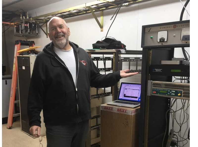 SUBMITTED PHOTO - Jeff Cotton, at the Grizzly transmitter site, recently established a low-power, nonprofit FM station, KJIV-FM (96.5) that plays a very diverse, eclectic menu of music.