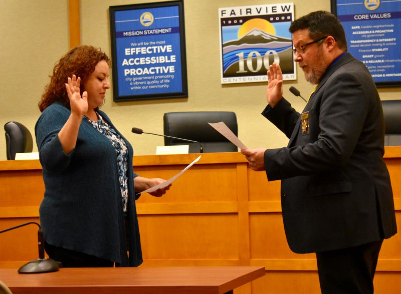 OUTLOOK PHOTO: MATT DEBOW  - Natalie Voruz is sworn in to Fairview City Council Position 5 by Fairview Police Chief Harry Smith.