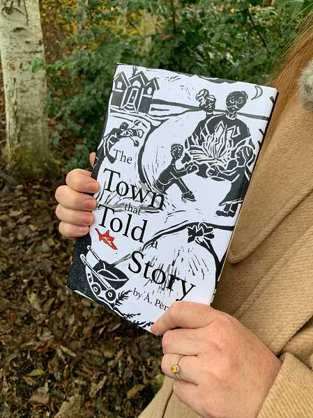 STAFF PHOTO: JANAE EASLON - 'A Town that Told a Story,' written by local author A. Penn, is available in shops like Perks of Art and Slow Rise Bakehouse.