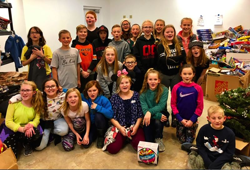 Children from Beavercreek Elementary volunteered with the Toy & Joy effort to spread holiday cheer to struggling families.