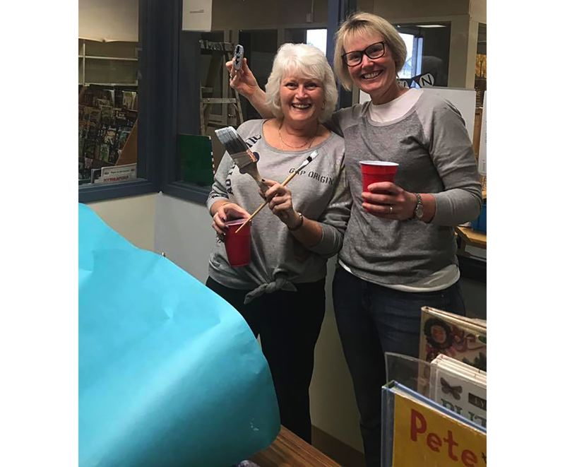 Volunteers helped repaint the library at McLoughlin Elementary, using paint donated by SRK Painting Inc.