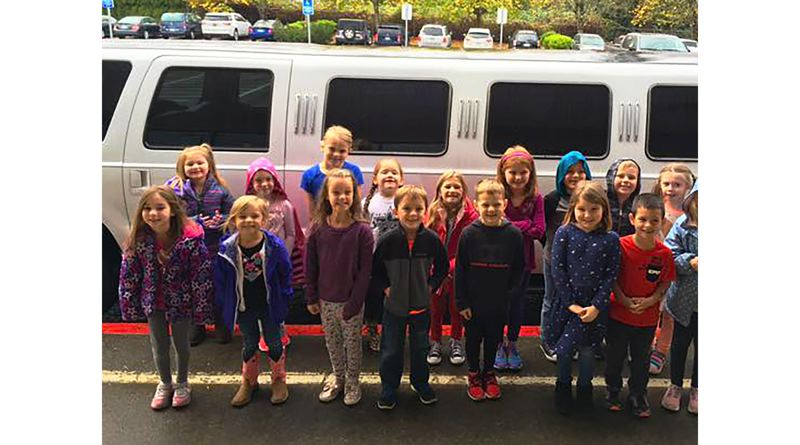 The class who raised the most money to hire a P.E. teacher was rewarded with a stretch limousine ride to McDonalds for lunch.