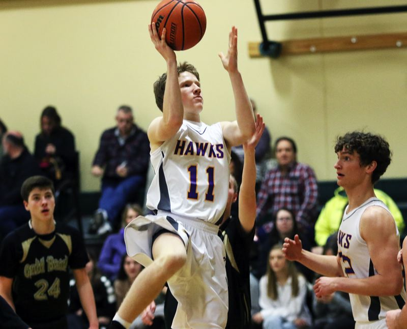 TIMES PHOTO: DAN BROOD - Horizon Christian junior guard Cade Tillema goes up to the basket during the Hawks win over Gold Beach at the Crusader Classic New Years Invitational.