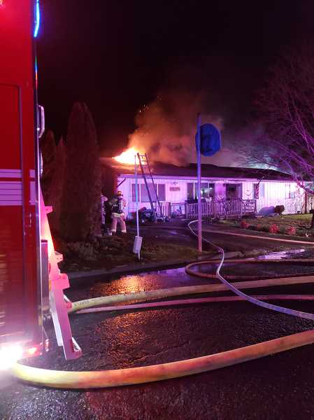 MFD - Molalla Fire crews tackle flames at a Carol Court home early morning on Sunday, Jan. 6.