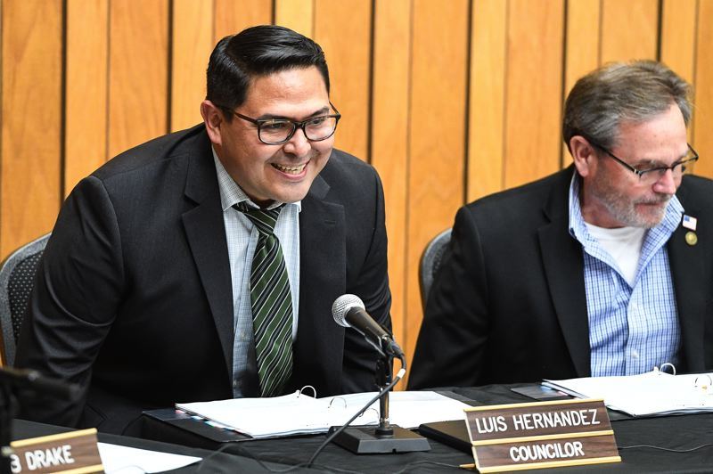 STAFF PHOTO: CHRISTOPHER OERTELL - Cornelius City Councilor Luis Hernandez takes his seat at the dais for the first time Monday, Jan. 7.