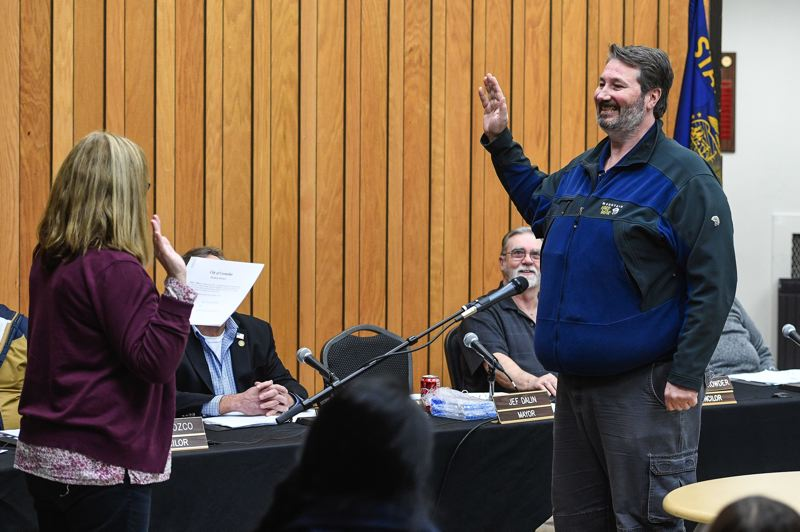 STAFF PHOTO: CHRISTOPHER OERTELL - Cornelius Mayor Jef Dalin is sworn in for another term by City Recorder Debby Roth, left, on Monday, Jan. 7.