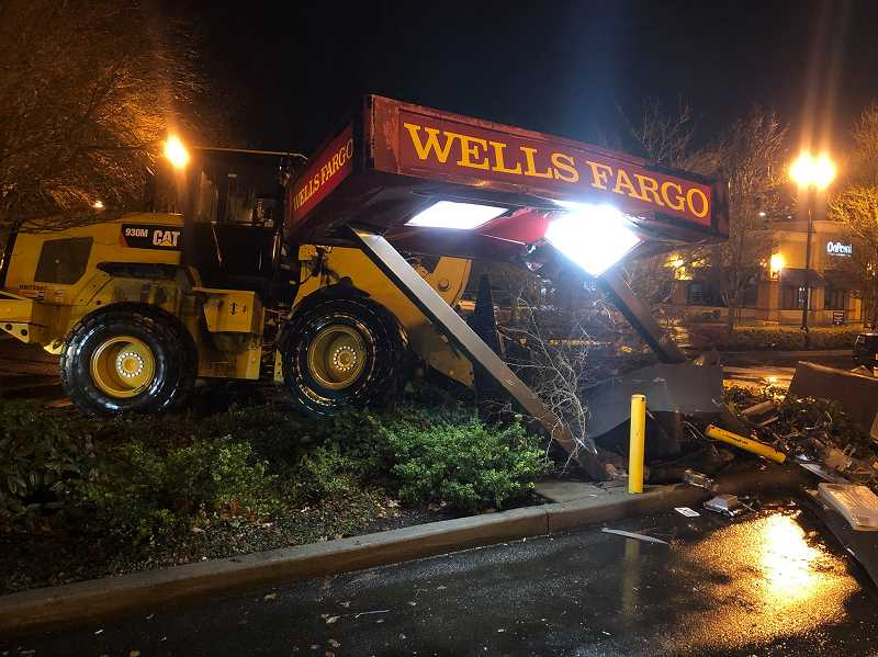 COURTESY: HILLSBORO POLICE - Authorities are searching for two men who reportedly drove through a Wells Fargo ATM with a large tractor early Tuesday morning.