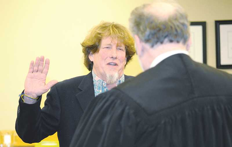 GARY ALLEN - Rick Rogers is sworn in as mayor of Newberg Monday during a city council meeting.