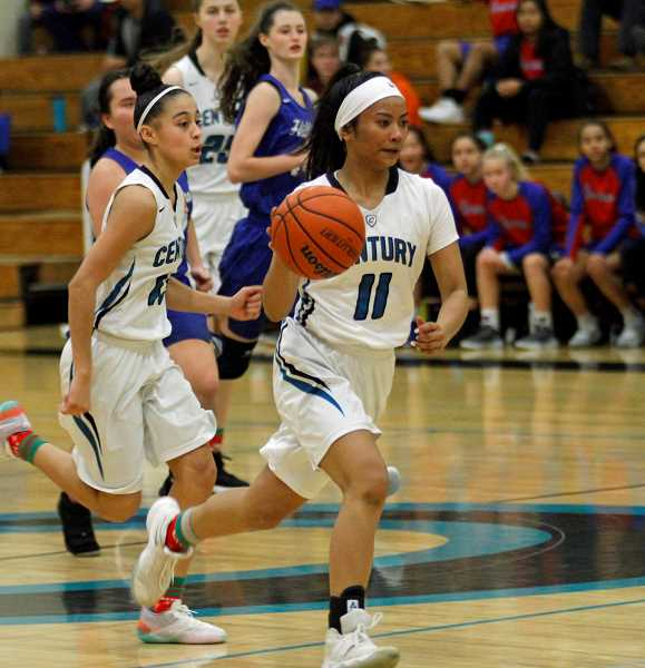 STAFF PHOTO: WADE EVANSON - Century's Janelle Maligaya (11) and Angie Baltazar (13) during a game against Hillsboro Saturday, Dec. 29, at Century High School. The guards are key contributors to the Jaguars this season.