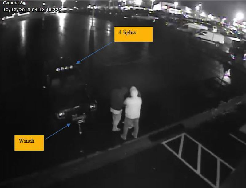 PHOTO COURTESY GRESHAM POLICE - This grainy sureillance photo shows the alleged perpetrators and the Jeep they drove.