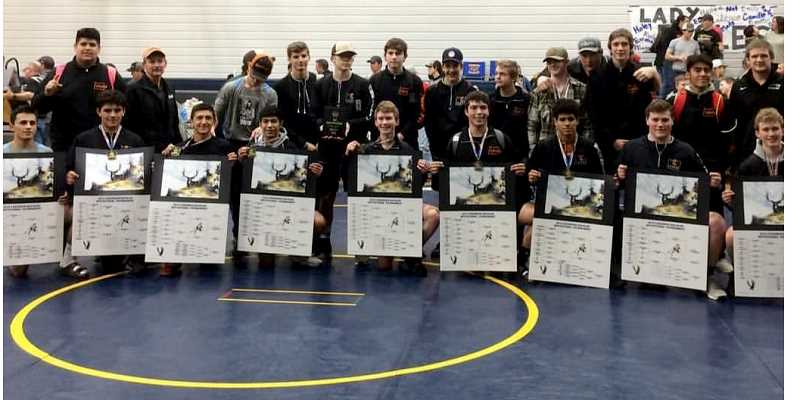 SUBMITTED PHOTO - Front row, to right, Lorenzo Vasquez, Eduardo Penaloza, Anthony Hood, Noel Navarro, Jordan Piercy, Joe Russo, Isaiah Tommey, Cylus Hoke, and Brody Piercy hold up their first-place brackets with the rest of the Bulldog wrestling team behind them. Culver won nine finals matches and all of them were by fall at the Joseph High School Tournament of Jan. 4-5.