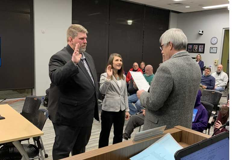 Shawn Varwig and Tracie Heidt (left) are sworn in to their Canby City Council seats by Judge Rod Grafe at the Jan. 2 council meeting.