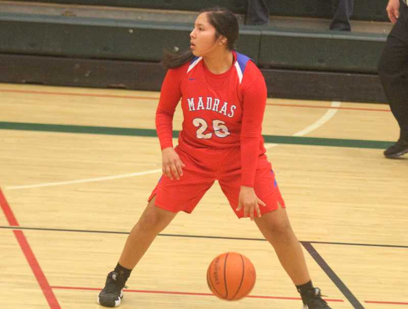 STEELE HAUGEN - Jiana Smith-Francis controls the ball and looks up the court. The Buffs lost to Mountain View 62-59 on Jan. 4. (Photo from Dec. 27.)