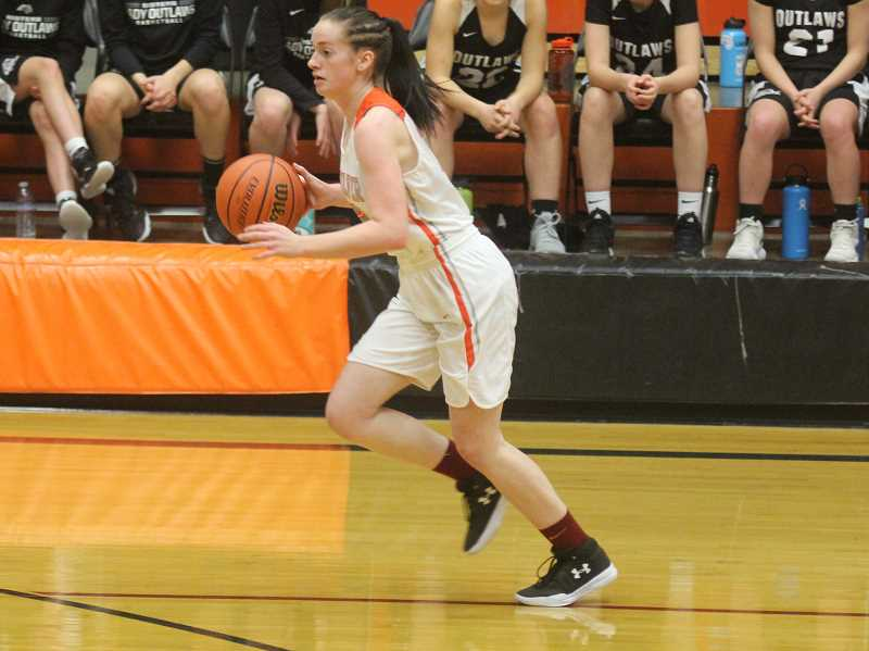 STEELE HAUGEN - Mikayla Haessler dribbles the ball during a fast break. The Lady Dawgs beat the Sheridan Spartans 56-35 on Jan. 3, to start the season 10-1. (Photo from Dec. 26.)