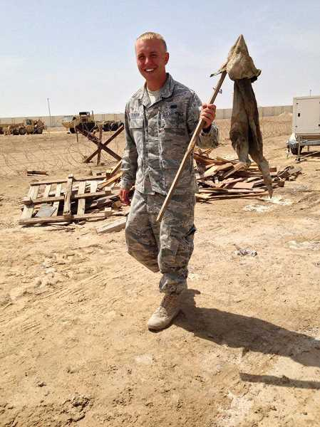 COURTESY PHOTO - Pacific University's Jimmy Calhoun poses for a photo during his time in the Middle East as part of the United States Air Force.