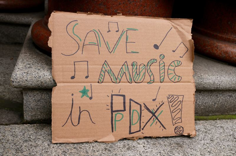 TRIBUNE PHOTO: ZANE SPARLING - A protest sign leans against the pilliars of Portland City Hall on Jan. 5. It highlights the number of brick-and-mortar buildings that are used as music venues