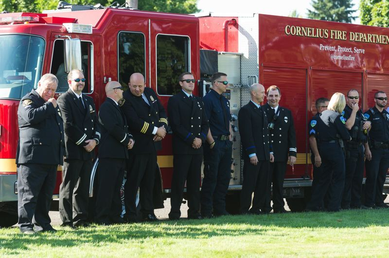 STAFF PHOTO: CHRISTOPHER OERTELL - A Cornelius Fire Department engine and firefighters represent the city at a Sept. 11, 2017, memorial ceremony in Forest Grove.