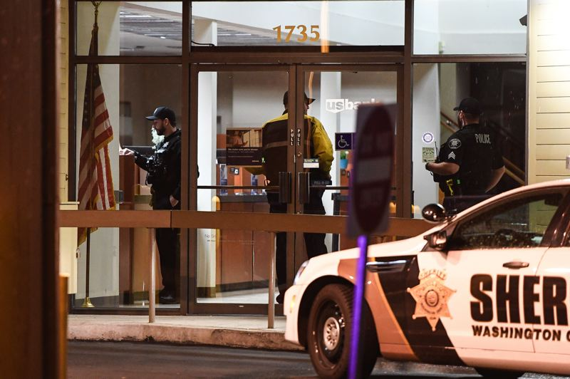 STAFF PHOTO: CHRISTOPHER OERTELL - Law enforcement personnel search U.S. Bank in Cornelius after a reported bank robbery Tuesday evening, Jan. 8.