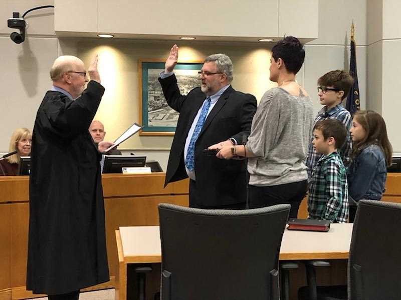 COURTESY OF JOHN COOK - Tigard Municipal Court Judge Michael J. OBrien swears in new mayor Jason Snider Tuesday night.
