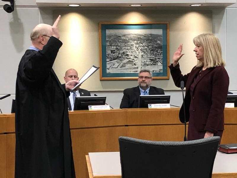 COURTESY OF JOHN COOK - Tigard Municipal Court Judge Michael J. OBrien swears in new councilor Liz Newton Tuesday night.