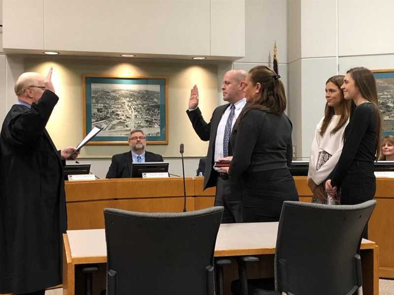 COURTESY OF JOHN COOK - Tigard Municipal Court Judge Michael J. OBrien swears in Councilor John Goodhouse Tuesday night.